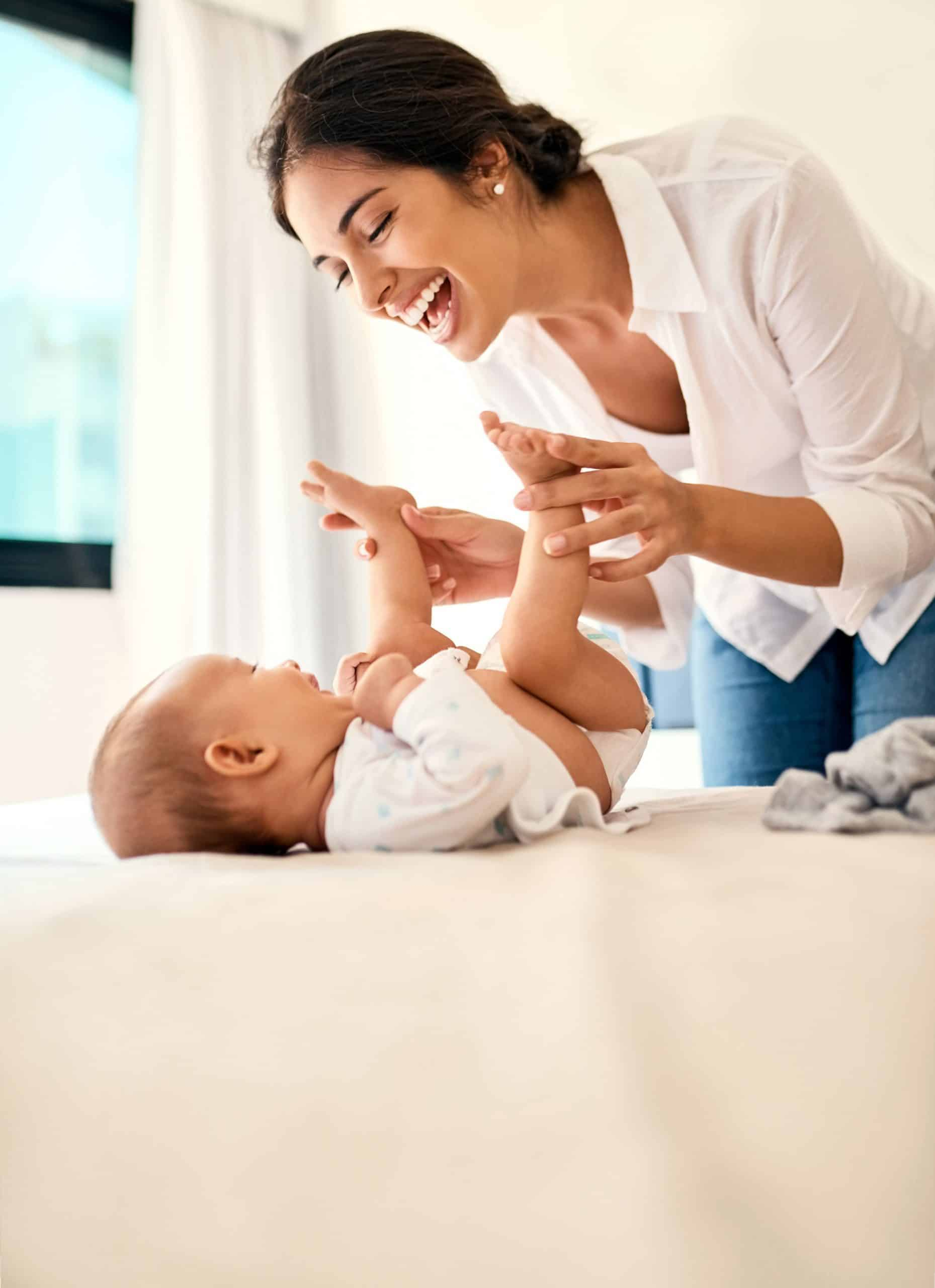 mother laughing with baby